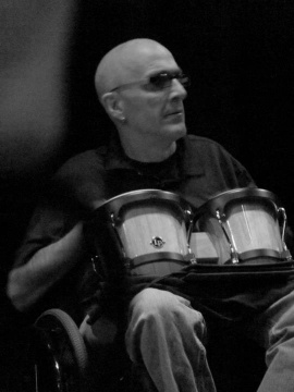 Man in wheelchair with bongos